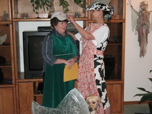 Jeanette receiving her cap from my sister Kathy.  Make note, Kathy is wearing her cap over her cow print cowgirl hat ~ nuts!